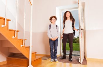 Brother and sister arriving home after school